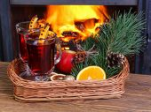 Mulled Wine On A Wicker Tray On A Background Of Fireplace