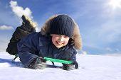 happy boy on sled