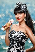 Bright picture of pretty woman with ice-cream on the beach
