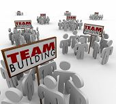 Team Building people gathered meeting around signs in training or group sessions to learn teamwork a