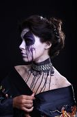 Dark Gothic Expressive Woman on Plain Background