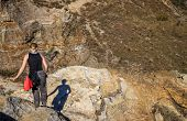 Woman trekking on rocky trail