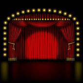 stage with red curtain and lights