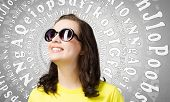 Young girl teenager in sunglasses and yellow shirt