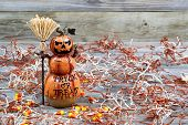 Scary Large Orange Pumpkin Ceramic Figure On Rustic Wood