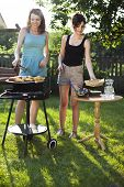 Two girls on grill