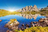 Great view of the sunny Lago Rienza - Ursprung in National Park Tre Cime di Lavaredo. Dolomites, Sou