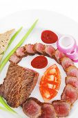 meat savory : roasted bbq meat served on white plate with tomatoes , sprouts and bread isolated on w