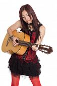 Young Asian girl with guitar, isolated on white.