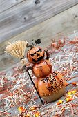 Scary Large Orange Pumpkin Ceramic Figure On Old Wood