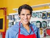 Portrait of handsome young worker smiling in hardware shop