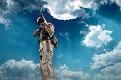 Soldier under sky