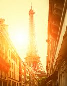 Sun light on the street with view on the Eiffel Tower