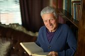 Handsome retired man reading book