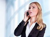 Closeup portrait of cheerful smiling businesswoman talking on phone, making deal, professional commu