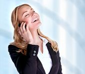Closeup portrait of cheerful smiling businesswoman talking on phone, making deal, professional communication, business and success concept