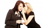 Business gossip. Women in the office. Two girls discuss the news at lunchtime with coffee. Gossip, r