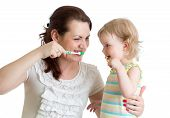 Child With Mom Brushing Teeth