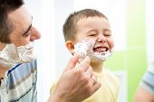 Playful Kid And Father Shaving Together At Home Bathroom
