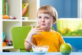 Breakfast For Kid Boy. Baby Eating Healthy Food.