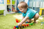 picture of pretty-boy  - kid boy playing with construction toys indoor - JPG