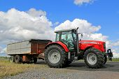Massey Ferguson 7465 Agricultural Tractor Parked By Field