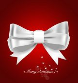 Christmas background. Shiny ribbon on red background. Vector illustration.