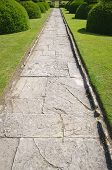 Stone Alley In English Formal Garden
