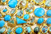 Golded jewel with turquoise