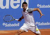 BARCELONA - APRIL, 24: Spanish tennis player I�?�±igo Cervantes in action during a match of Barcelona tennis tournament Conde de Godo on April 24, 2014 in Barcelona