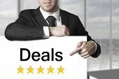 Businessman Pointing On Sign Deals Golden Rating Stars