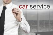 Businessman Writing Car Service In The Air