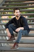 Cool Guy In Black Clothing Sitting On Steps