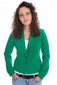 Isolated smiling young woman in green with stop curls looking sideways.