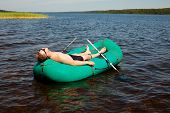 Man resting in a rubber boat