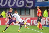 VIENNA, AUSTRIA - SEPTEMBER 18 Daniel Royer (#28 Austria) and Josu�?�?�?�© (#8 Porto) fight for the ball at a UEFA Champions League game on September 18, 2013 in Vienna, Austria.