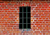 Old Window With Bars In Brick Wall