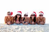 friendship, happiness, summer vacation, holidays and people concept - group of friends in santa help