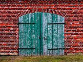 Old Wooden Gate In Brick House
