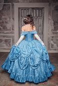 foto of medieval  - Beautiful medieval woman in long blue dress back - JPG