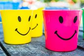 Beautiful colorful plastic drinking cup with a lovely smile