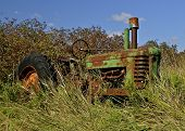 Rusty old tractor in the brush