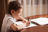 Boy doing homework. Child education