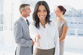 Businesswoman offering a friendly handshake at work