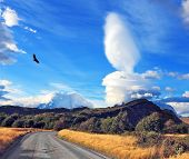 The impressive cloud over Patagonia. Amazingly beautiful sunset illuminates the distant mountains an