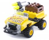 Ankara, Turkey - June 21, 2013:  Lego yellow safari car isolated on white background.