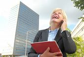 Happy Businesswoman With Tablet And Mobile