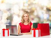 christmas, holidays, technology and people concept - smiling woman in red blank shirt with shopping