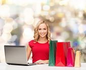 christmas, holidays, technology, advertising and people concept - smiling woman in red blank shirt w