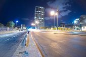 image of israel people  - Wide angle long exposure view of the Tel Aviv Israel beach promenade at night with blurred people and riders and towers in the background.